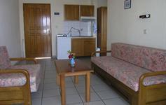 Obývací pokoj s kuch. koutem v apartmánu